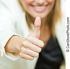 Businesswoman with her thumbs up in an office