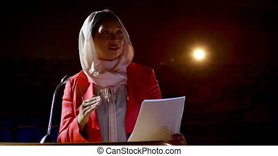 Businesswoman with hijab speaking in business seminar at ...