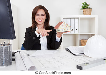 Businesswoman With Home Model