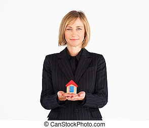 Businesswoman with house for real estate concept