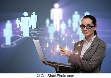 Businesswoman with laptop in social network concept