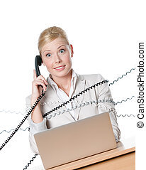 Businesswoman with laptop tied with phone wire