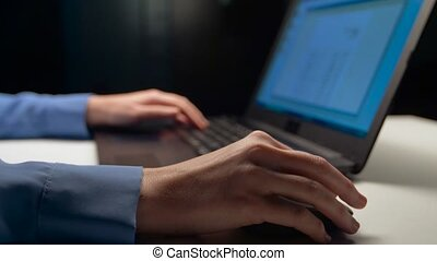 businesswoman with laptop working at night office -...