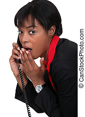 Businesswoman with look of surprise on her face