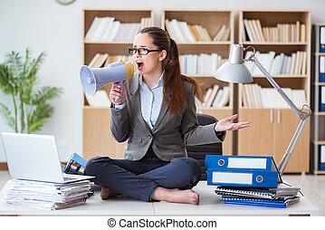 Businesswoman with loudspeaker in office