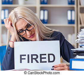 Businesswoman with message in office at desk