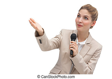 Businesswoman with microphone pointing at something