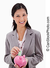 Businesswoman with money and piggy bank