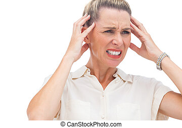 Businesswoman with painful headache and hand on head