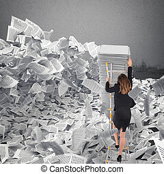 Businesswoman with paper sheet anywhere. Buried by ...