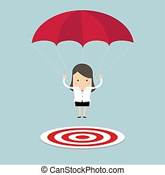 Businesswoman with parachute focused on a target.