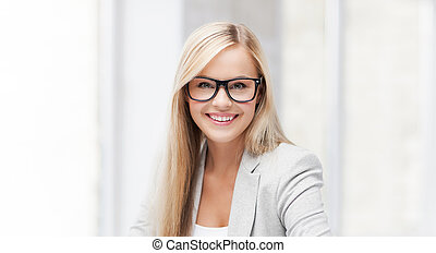 businesswoman with pen - indoor picture of smiling woman...
