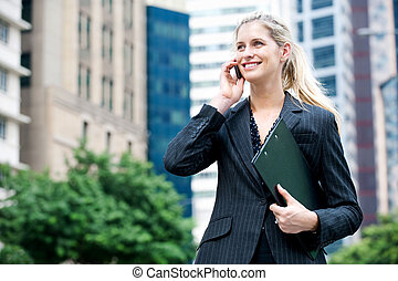 Businesswoman with Phone and Files