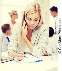 businesswoman with phone in office