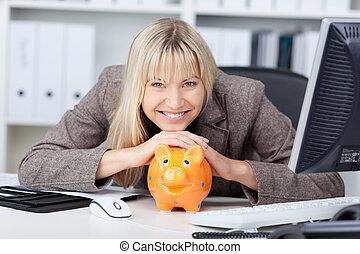 Businesswoman With Piggypank At Desk - Portrait of ...