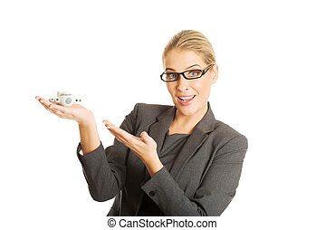 Businesswoman with plane toy in hand