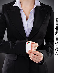 Businesswoman With Playing Cards Hidden Under Sleeve