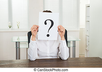 Businesswoman With Question Mark On Paper