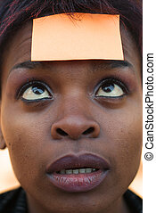 Businesswoman with reminder post it note