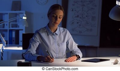 businesswoman with smart watch at night office - business,...