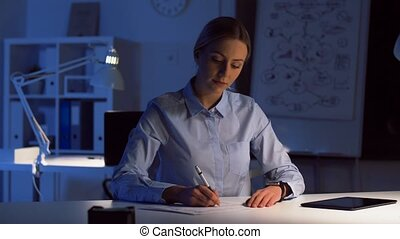 businesswoman with smart watch at night office