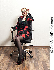 businesswoman with sunglasses in chair