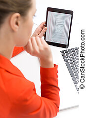 businesswoman with tablet and laptop thinking over idea....