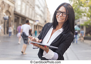 Businesswoman With Tablet Computer on street