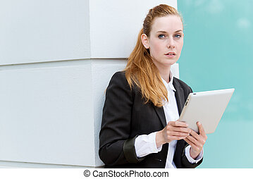 Businesswoman With Tablet PC - Serious redhead businesswoman...