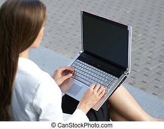Businesswoman with the notebook