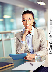Businesswoman with touchpad - Portrait of confident employee...