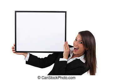 Businesswoman with white board