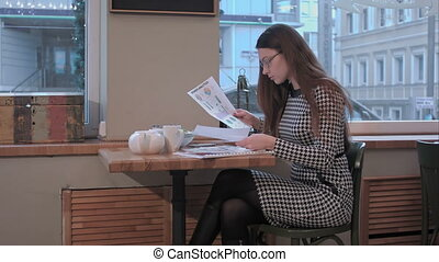 Businesswoman work with documents in cafe