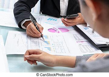 Businesswoman working and analyzing
