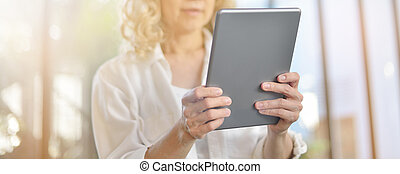 Businesswoman working and using tablet computer in office