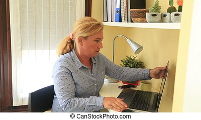 Businesswoman working at home - Blonde businesswoman working...