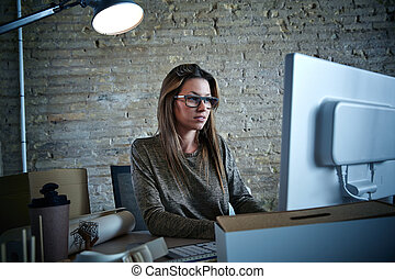 Businesswoman working computer at office