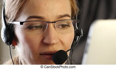 businesswoman working in a call center. customer service proffessional talking on headset. 4K