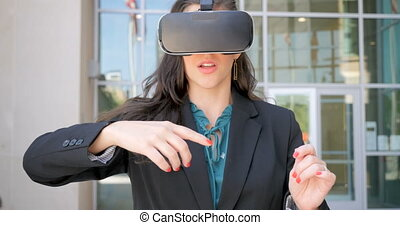 Businesswoman working in virtual reality with VR headset celebrating success