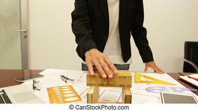 Businesswoman working on blueprint at desk 4k - ...