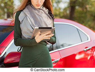 Businesswoman working on digital tablet outdoor