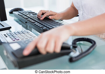 Businesswoman working on her computer