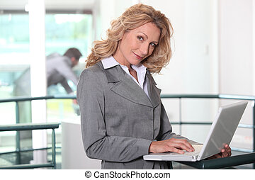 Businesswoman working on her laptop