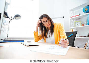 Businesswoman working on her workplace in office
