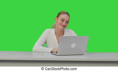 Businesswoman working on modern laptop,having video conference with partners on a Green Screen, Chroma Key.