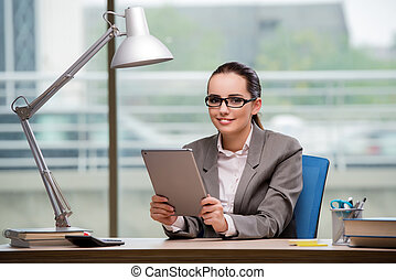 Businesswoman working on tablet computer