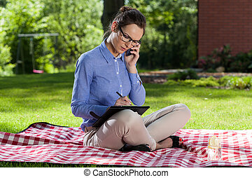 Businesswoman working outdoors
