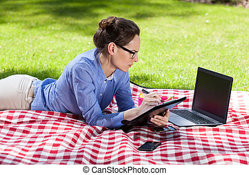 Businesswoman working outdoors with her laptop