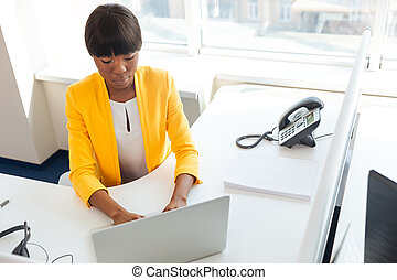 Businesswoman working with laptop computer