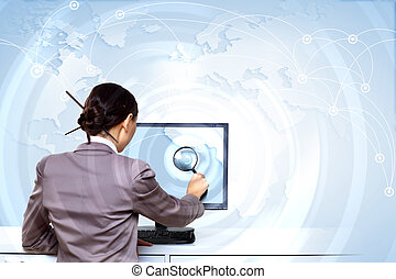 Businesswoman working with virtual digital screens